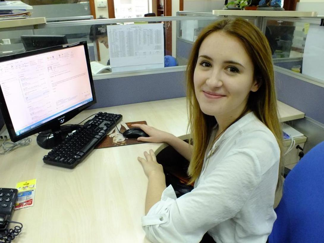 On a law internship abroad in China, an intern smiles as she works at her desk